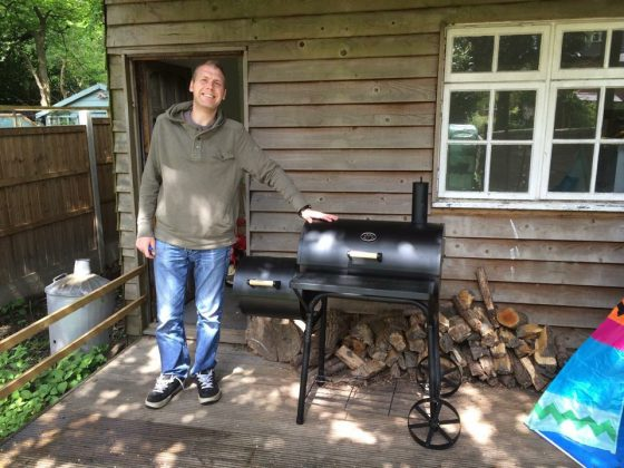 He's very proud of his BBQ!