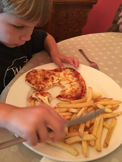 He loved the naan bread pizza at Moonfleet Manor, but struggled with the dining room