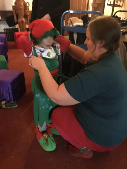 Oscar takes a shine to Mistletoe the Elf's uniform. So she gives it to him to wear!