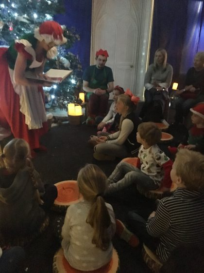 You're not seeing things. Thats Oscar. Sat on a carpet. with other children. Listening to a story. Regardless of how long that lasted it happened and I couldn't have been prouder. The fact that Mrs Claus was wonderful and read such a cute story may have helped!